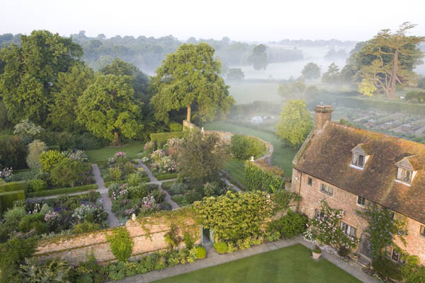 Sisinghurst. Early morning misty view of the Rose Garden, seen from the Tower at Sissinghurst Castle Garden, near Cranbrook, Kent.